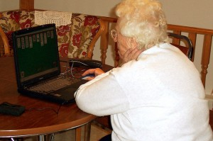 Grandma on a computer by Flickr/mhofstrand